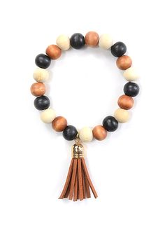 Our Wooden Bead Tassel Bracelet is both natural and stylish, which will give your outfit a more earthy look. Both stretchy and comfortable, this bracelet will fit any wrist.
