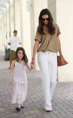 I like Katie Holmes laid back style. Wide leg pants and button up blouses.