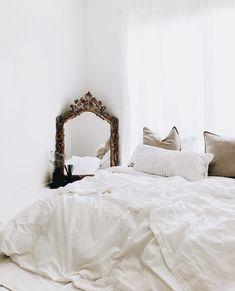 Simple, minimal white bedroom