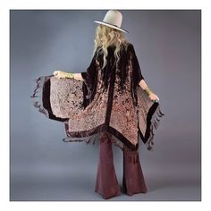 """Stunning bohemian babe kimono.  To-die-for velvet burnout is illuminated by winks of hand beading and trailed by silk tassels. Gorgeous contrasting cream colored floral pattern with thee most beautiful rainbow iridescent beads for extra magic.So many ways to style...dressed up or down..effortless and timeless!One size fits all When draped on the length is 30.5"""" at the shortest point; 44"""" at the longestSilk velvet Silk beaded tassels Dry Clean"""