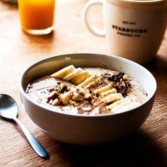 Cinnamon Polenta-Oats porridge w/ dried figs & raisins topped w/ #raw carob & peanut sauce Banana + handful of various nuts + sesame & flaxseeds