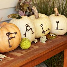 Use antique keys to spell out F-A-L-L on pumpkins (secure with long straight pins). More fall decorating ideas: http://www.midwestliving.com/homes/seasonal-decorating/fall-door-decorating/p