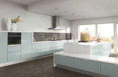 Beautiful Kitchens loves this striking, handless scheme by Caple. Featuring flush-fitting cupboards and neat, top-fitted door and drawer handles, the design comes in a sparkling cool blue hue that's both calming and on trend.