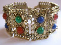 Vintage Bracelet Wide Gold Tone Etruscan Style Panels With Jewel Tone Cabochons. $26.00, via Etsy.