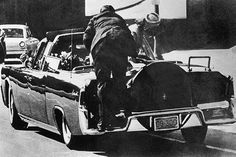 The car turned off Main Street at Dealey Plaza around 12:30 p.m. As it was passing the Texas School Book Depository, gunfire suddenly reverberated in the plaza.Bullets struck the president's neck and head and he slumped over toward Mrs. Kennedy. The governor was also hit in the chest.The car sped off to Parkland Memorial Hospital just a few minutes away.