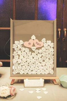 Adorable Guest Book idea-Guests sign their name on a little wooden heart and drop it in a shadow box frame.