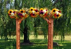 Google Image Result for http://www.countrybouquetsfloral.com/images/portfolio/large/Our%2520Wedding%2520Arch_large.jpg