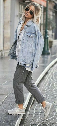 street style. casual. denim jacket. grey trousers. sneakers.