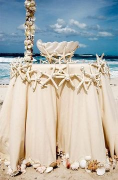 Ceremony table decorated with shells, starfish, and pearls / http://www.himisspuff.com/starfish-beach-wedding-ideas/4/