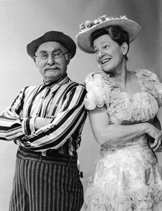 Minnie Pearl, shown here with Grandpa Jones, was born Sarah Ophelia Colley Cannon on October 25, 1912. She was an American country comedienne who appeared at the Grand Ole Opry for more than 50 years (from 1940 to 1991) and on the television show Hee Haw from 1969 to 1991.