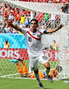 Costa Rica's Bryan Ruiz celebrates after scoring his side's first goal over Italy's goalkeeper Gianluigi Buffon during the group D World Cup soccer match between Italy and Costa Rica at the Arena Pernambuco in Recife Brazil Friday June 20 2014 World Football, Football And Basketball, Soccer Players, World Cup 2014, Fifa World Cup, Lionel Messi, Bryan Ruiz, Soccer Match, Latest Sports News