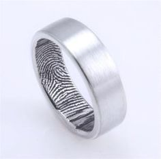 Wedding band with spouse's fingerprint on the inside. I wish the John Christian jewelers could do this, I like their rings a lot more than the plain brushed band.