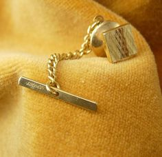 Gold Filled Diamond Cut Cube Tie Tac with Chain Vintage Marked Germany Wedding Valentines Day. This is a highly detailed handsome engraved tie tac with chain. The chain is marked Germany on the cross piece. This tie tac is in good vintage condition, well made and medium weight. Great for a wedding, anniversary or Valentine's Day. jan18 2014
