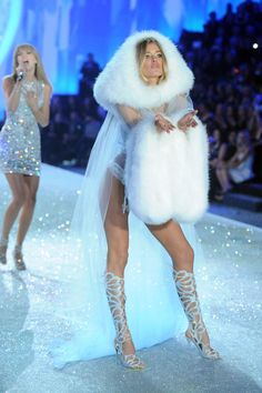 Model Doutzen Kroes (R) walks the runway and singer Taylor Swift performs at the 2013 Victoria's Secret Fashion Show at Lexington Avenue Armory on November 13, 2013 in New York City.