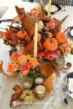 Blue Ribbon Kitchen | Thanksgiving cornucopia table idea.  Oranges, pumpkins, feathers fall centerpiece.