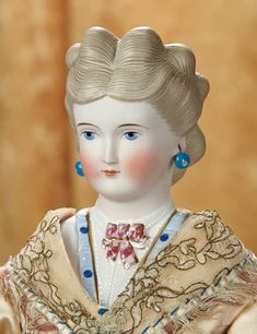 """19""""-German Bisque Lady Doll with Brown Hair and Elaborate Bodice~~~sculpted bodice with elaborate and colorful detail of embroidery with gilt-accented neck bow, muslin stitch-jointed body, leather arms, lovely antique silk costume. Comments: Germany, circa 1870, attributed to C.F. Kling."""