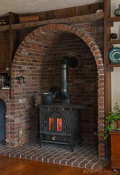 Stove Nook Wood Stove Nook - works because the radiant heat lingers in the brick (stone, concrete, slate) thicker the better.Wood Stove Nook - works because the radiant heat lingers in the brick (stone, concrete, slate) thicker the better. Old Stove, Stove Fireplace, Wood Stove Hearth, Brick Hearth, Fireplace Ideas, Wood Stove Surround, Diy Wood Stove, Fireplace Stone, Concrete Fireplace