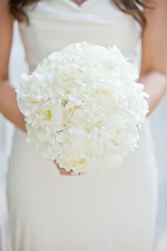All white wedding bouquet with peonies at this Modern Florida Wedding by 1313 Photography