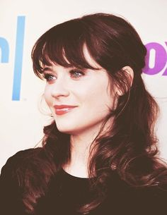 Zooey Deschanel, looks like rory from Gilimore Girls.. i want her wrinkle cream!