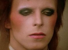 Maybe worth focusing on Bowie's extreme stage makeup instead, circa Ziggy Stardust era? Then could keep red hair throughout story?