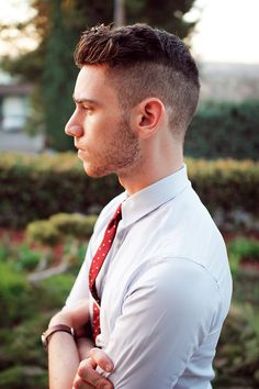 short mens hairstyles... shaved on the sides, poofy but controlled on top