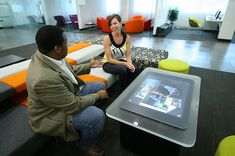 10 Cool Office Spaces - Forbes. Microsoft employees pull up a seat around this large touchscreen tablet table.