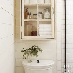 Maximize your bathroom storage space—and keep the room looking good—by making use of the area above and around your toilet. We'll show you how to install shelving units, cabinets, ladders, and more so your bathroom can store more in style. Bathroom Medicine Cabinet, Toilet Storage, Storage Spaces, Apartment, Bathroom, Toilet, Storage, Bathroom Shelving Unit, Storage Solutions
