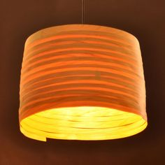 "Each ""Wooden Path"" lampshade is made of a continuous strip of veneer that in a circular motion, like a spiral path down the hill, becomes a cylinder filled with warm light. The natural texture of the strips gives each lamp its individual character. http://www.mavestore.com/product/wooden-path-veneer-lampshade-small"