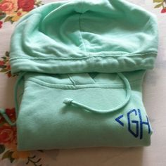 Mint green Gilly Hicks hoodie A mint green hoodie in the size small .it runs big like annoy friend sweater with blue GH accent on the left breast also blue base ,It is a high low hoodie where the blue base is meant to be seen Gilly Hicks Sweaters