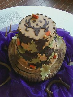Bone Collector cake - I made this at the request of the bride. I had a mix up in my order for the leaf cutter needed to create this cake, so I ended up having to make my own cutter. I think it ended up looking great, and I learned something new!