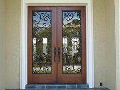wrought iron double front door digging these - Double Front Doors