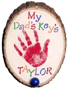 Key Hook for Dad. This Father's Day, the kids can help create a rustic key hook for Dad set on an actual tree section with natural bark and decorated with a kid's hand-print. Any Dad would love this homemade gift.