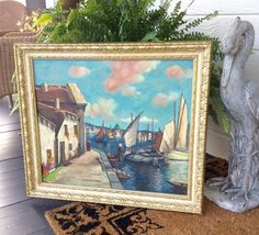 This is a beautiful, original oil on canvas, large painting in a gold ornate, period, wood frame! Italian Artist  Aldredo Caldini born 1917. No signature, but canvas on back has stamped artist name & painting ( Sailors Snug Harbor by Alfredo Caldini). Painting is in very good vintage condition, clean, with no apparent damage! Simply gorgeous! Done in colors of coastal blues! Has vintage rope on back for hanging. Please enlarge photos, & convo if you have any questions. The painting was…