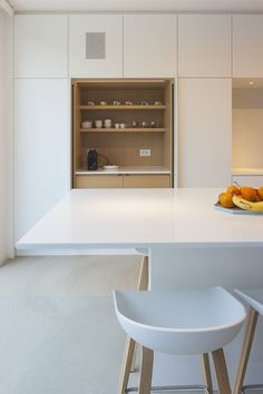 white kitchen with wood cabinet detail