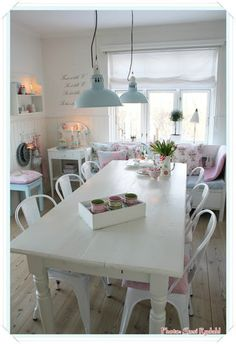 white makes this small space bigger but love the cozy feel and the table and chairs are great
