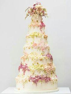 Beautiful wedding cake.  I love the flowers.