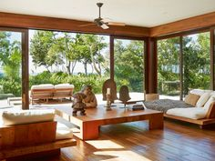 Floor-to-ceiling windows unite the tropical gardens with the pared-down interior. Oasis, Surf, Floor To Ceiling Windows, Outdoor Furniture Sets, Outdoor Decor, Building A House, House Design, Flooring, Living Room