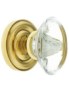 """Oval crystal knobs measure 2 3/4"""" H x 1 3/4"""" W. Rosettes measure 2 9/16"""" in diameter."""