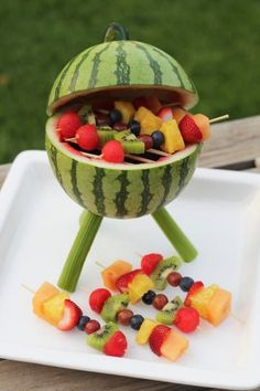 Watermelon Grill with Fruit Kabobs Make a watermelon centerpiece that's functional and edible. Add some fruit kabobs and you've got a BBQ grill that will thrill. Grilled Watermelon, Watermelon Fruit, Watermelon Carving, Carved Watermelon, Watermelon Ideas, Watermelon Centerpiece, Fruits Decoration, Fruit Creations, Creative Food Art