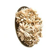 Karin Roy Andersson. Brooch: A Constant Grinding, 2012. Galia melon seeds, titanium, aluminium steel, silver.
