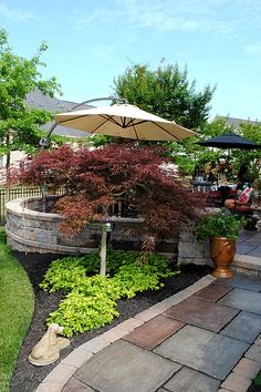 8 Great Ideas for Backyard Landscaping! - The Graphics Fairy//just like the looks of; wall stone planting area &...