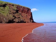 The Red Sand Beach in Rabida, Galapagos is from the oxidization of iron in its lava deposits mixed with washed up coral pieces turning into sand.