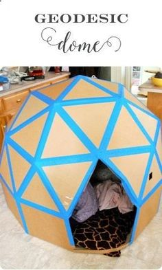 Geodesic Dome cardboard house - Fun things to do with your kids on cold days! Lots of ideas in this post from Little Girls Pearls! #catsdiycardboard