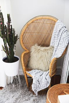 wooden woven accent chair and potted cactus // Love the mix of textures here from the wood to shag carpet