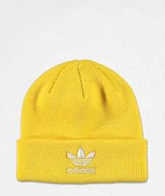 Rock a sporty look when the temps drop with the Trefoil yellow and white beanie from adidas Originals. This bright yellow beanie features a foldover cuff and fine knit construction. A white Trefoil logo is added to the cuff to complete the look of this mu Adidas Beanie, Yellow Beanie, White Beanies, Retro Shirts, Mens Fall, Sporty Look, Streetwear Brands, Look Cool, Beanie Hats