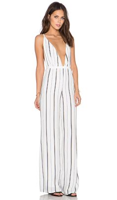 e0161845a361 Shop for FAITHFULL THE BRAND Shutterbabe Jumpsuit in St Barths Stripe at  REVOLVE. Free 2-3 day shipping and returns
