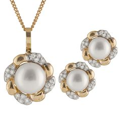 10k Gold pendant and matching earrings with 7-8mm freshwater pearls and 0.24CT diamonds