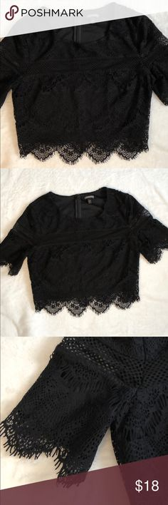Express Black Lace Crop Top Step up your crop top game with this sexy black top with lace trimmings.   Polyester lining. Nylon and spandex mesh. Polyester shell.   Super gently used; worn about 2x.   Bundle with other products for a special discount! Express Tops Crop Tops