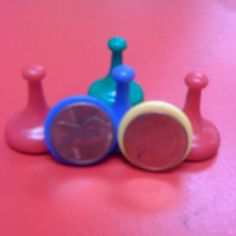 Use old game pieces to make money stamps to use in the math center.