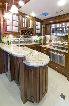 New 2014 Tuscany 40KQ Luxury Diesel Motorhome's Peninsula Kitchen w/ Wine Rack & Fridge from Thor Motor Coach.